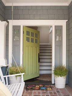 Painting your front door is one of the best ways to add curb appeal to your home. Get inspired by these tried and true front door paint colors! Cottage Front Doors, Green Front Doors, Painted Front Doors, Front Door Colors, Cottage Door, Exterior House Colors, Exterior Paint, Gray Exterior, Style At Home