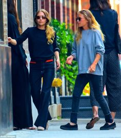 Not such a fashionable habit! Mary-Kate and Ashley Olsen puff on cigarettes outside their ...