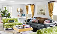 A bold ikat, Matisse by Ballard Designs, on matching settees from Mitchell Gold + Bob Williams energizes a small living room.