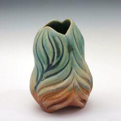 Curvy carved porcelain bud vase in green tan & by robertapolfus