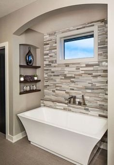Tile accent wall upstairs bath as backwall. Dusty blue grey accent tile pieces