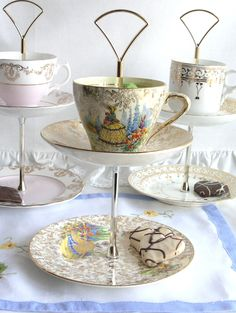 2 tier mini cake stand / jewelry display DIY? - upcycled English Empire china cup, saucer and plate with crinoline lady pattern. $42.00, via Etsy.