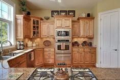 Traditional Kitchen with Limestone Tile, Hardwood floors, Raised panel, Silestone-Quartz Countertop in Sienna Ridge, Flush