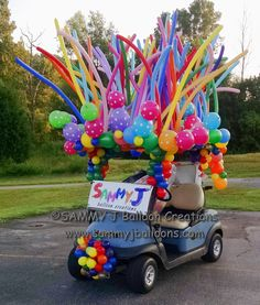 Cart decoration for Fenton Area Chamber golf tournament. A great way to promote unique balloons! Homecoming Floats, Homecoming Parade, Christmas Parade Floats, Floats For Parade, 4th Of July Parade, July 4th, Custom Golf Carts, Golf Gifts For Men, Golf Theme