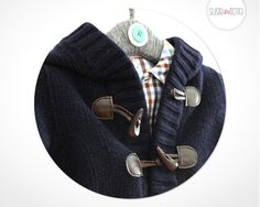Gorgeous, woollen hooded jacket by Kuxo Toggle closure and ribbed knit edging.