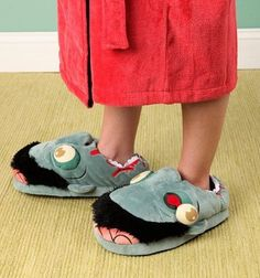 http://geekandhip.com/product/zombie-plush-slippers/