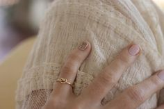 Ariel Gordon Love Knot Ring - comes in sterling silver, yellow gold and rose gold. I think I want the rose.