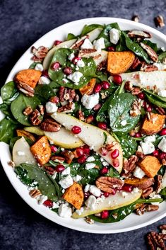 Beautiful and festive roasted sweet potato, pear and pomegranate spinach salad with creamy goat cheese, toasted pecans and a tangy balsamic dressing! Perfect for the holidays. Cooking Sweet Potatoes, Roasted Sweet Potatoes, Plat Vegan, Potato Salad With Egg, Clean Eating, Healthy Eating, Salad Recipes Video, Winter Salad Recipes, Healthy Recipes