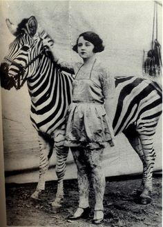 Circus beauty - Tattooed lady with zebra.