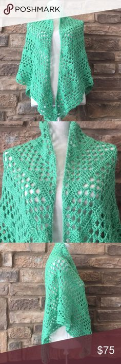 New Handmade crochet shawl Local artist hand-made shawl/shrug. Beautiful detail throughout. Definitely will keep the chill off during those cooler months. Beautiful green color with a slight sparkle. Price is firm due the detail, dedication, and time put into making this unique fashion piece. Handmade Sweaters Shrugs & Ponchos
