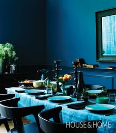 Moody Blue Table Setting  Chunky bronze candlesticks, unique decanters and shapely glass make a dramatic centerpiece decoration.