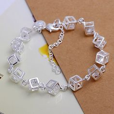 RUBIX CUBE 925 STERLING SILVER AND CZS BRACELET 925 sterling silver Rubix Cube bracelet with crystals in every box.  Unique.  *NWOT Rubique Jewelry Bracelets