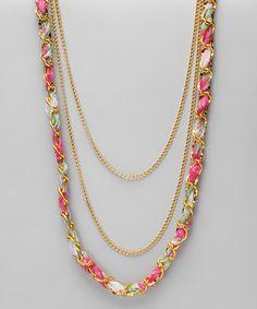 ribbon laced through chain . . .