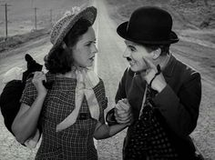Smile! Charlie Chaplin and Paulette Goddard in Modern Times, 1936.