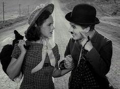 Smile! Charlie Chaplin and Paulette Goddard in Modern Times, 1936.