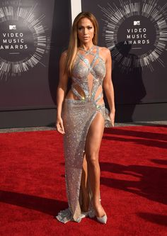Jennifer Lopez looked stunning on the red carpet in a silver Charbel Zoe silver cut out gown at the MTV Video Music Awards 2014.
