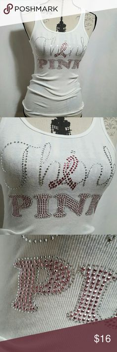 NWOT studded breast cancer tank Nwot So sexy breast cancer awareness think PINK racerback  tank.  Fabric stretches.  Please ask any and all questions before purchasing this item boutique Tops Tank Tops