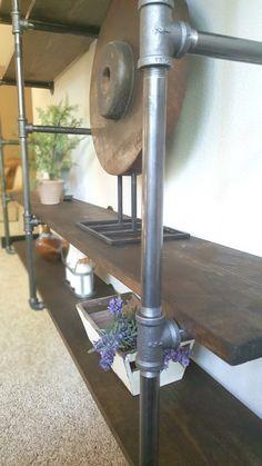 DIY industrial pipe shelves- modern yet rustic vibe