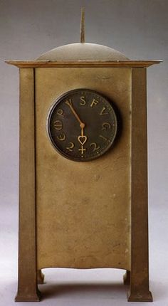 CFA Voysey Tempus Fugit clock produced in Aluminium by W.H. Tingey,and shown at the 1903 Arts & Crafts Exhibition.