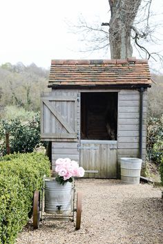 Farm Bloggers at Walnuts Farm — The Yvestown Blog | love the double Dutch door and for some odd reason, the black pipe running vertically up the right side of the shed! Oh and the peonies are beautiful!