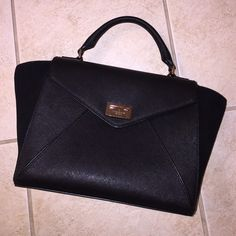 """KSNY Laurel Wesley Place Suede in Black KSNY Laurel Wesley Place Suede in Black. BNWT! This bag is versatile; you can pull in the sides and carry it as a square bag. You can also carry it as a crossbody! Measurements: 15"""" x 9"""" x 5"""", 4"""" strap drop. No trades or Paypal! kate spade Bags Satchels"""