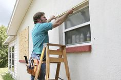 Photo about A man measuring windows for hurricane shutters or plywood. Image of prepare, home, professional - 941057 Standard Window Sizes, Hurricane Shutters, Electrical Fittings, Window Replacement, Glass Repair, Glass Installation, Window Repair, Window Frames, Window Film