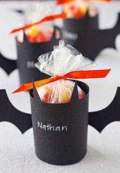 Bat Treat Holders -- Fill with treats and give to all of the little ghosts and goblins in your neighborhood, or use as batty Halloween party favors. Bricolage Halloween, Halloween Treat Holders, Dulceros Halloween, Halloween Party Snacks, Adornos Halloween, Manualidades Halloween, Halloween Birthday, Holidays Halloween, Birthday Fun