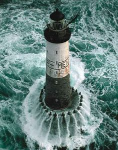 light house in rough ocean • rough seas • maritime theme • sailing high seas