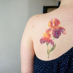 Healed Iris #torontotattoo #tattoo #watercolortattoo #iristattoo #flowertattoo #healed#toronto