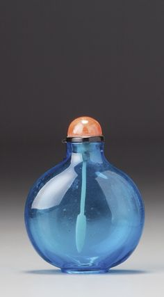 A PEACOCK-BLUE GLASS SNUFF BOTTLEATTRIBUTED TO THE IMPERIAL PALACE GLASSWORKS, QING DYNASTY, 18TH CENTURY