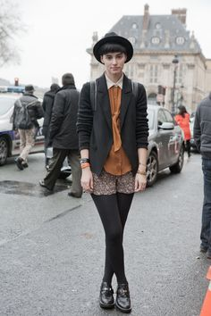 black blazer, caramel blouse, scalloped hem shorts, black tights, spiffy shoes and bowler hat.