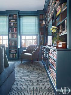 In the library of this Manhattan townhouse decorated by Vicente Wolf, the tufted armchair is covered in a metallic leather by Edelman; the carpet is by Stark.