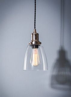The eye-catching Hoxton Domed Glass Pendant is matched with Satin Nickel fittings and retro Squirrel Cage bulb