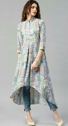 Buy Libas Multicoloured Polyester Printed High-Low Hem A-Line Kurta online in India at best price. Multicoloured printed A-line kurta, has a mandarin collar, three-quarter sleeves, curved high-low he Pakistani Dresses, Indian Dresses, Indian Outfits, Stylish Dresses, Casual Dresses, Fashion Dresses, Stylish Kurtis, Kurti Patterns, Dress Patterns