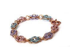 http://www.craftsinstitute.com/making-jewellery/projects/chainmaille/orbital-rays.aspx