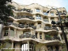 Barcelona,Spain..I went same year as Paris..these buildings are amazing,they were done by a famous architect. His designs are all over the city.The details he puts in balconies,etc look almost like a 3-D sculpture on their own in person.