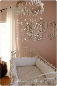 Beautiful baby girl mobile. PEARLS!! And I love the letters behind the crib as well... love this!