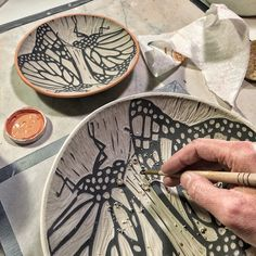 Working on a sgraffito carved butterfly bowl.