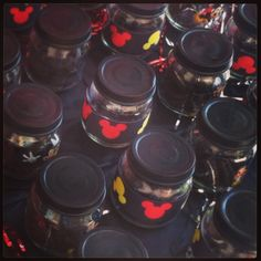 Mickey Mouse Party Favors!  Made from baby food jars, ribbon & stickers.  Filled with Mini Oreos