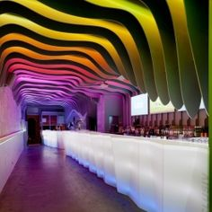 É Pra Poncha Bar by António Fernandez in Paris, France - This bar design takes on multiple-colored discotheque inspired by natural cave-like formation.