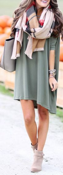 A blanket scarf, booties and khaki green dress make for a perfect fall outfit!