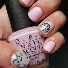 Show your love for cats by trying out these adorable cat inspired nails. The soft pink nail polish gives an overall playful feel.