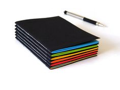 Soft cover notebook with neon pages by Cathy Durso