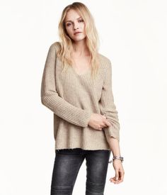 Soft, V-neck, rib-knit sweater with mohair content. Slits at sides of hem. Slightly longer at back.