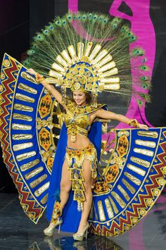 Miss Ecuador - Constanza Baez: Now that's a costume that really takes up the stage! Miss Ecuador showed off her country's roots with a Mayan-themed costume that channeled one of her home's most famous birds, the peacock. Credit: Darren Decker/Miss Universe2013