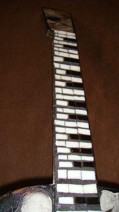 © 2009 Jenna Alderton Mosaic keyboard on guitar neck.