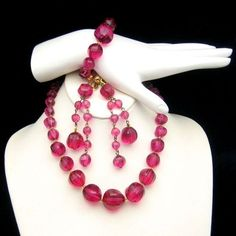 "LOVELY LUCITE! This gorgeous vintage necklace, bracelet, and earrings set features faceted ""faux crystal"" beads in pink and raspberry red - it would look right at home on the set of Mad Men! Vintage Pink Red Lucite Faux Crystal Necklace Bracelet Earrings Set, $99 from http://stores.ebay.com/My-Classic-Jewelry-Shop :)"