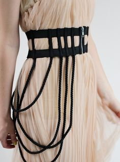 Chromat's elastic cage corset belt.. retardily expensive but i like the look - maybe worth making for my outfit.