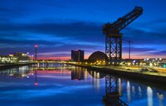 A modern city that has not lost a sense of its shipbuilding tradition... incorporating the old and the new on the Clydeside horizon...