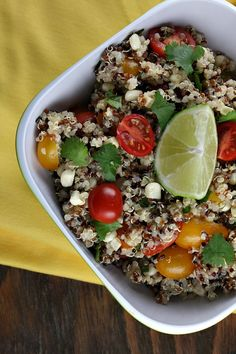 Mexican Quinoa Salad  1 1/2 tablespoons extra-virgin olive oil  2 tablespoons white wine vinegar  salt and freshly ground black pepper, to taste    Salad:  1 cup dry quinoa, rinsed well through a fine strainer/sieve  1 cup halved cherry tomatoes  3/4 to 1 cup fresh corn (sliced off the cob, raw)  1/4 cup finely chopped cilantro  lime wedges  salt and freshly ground black pepper, to taste